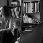 Julie Risbet at home among her books